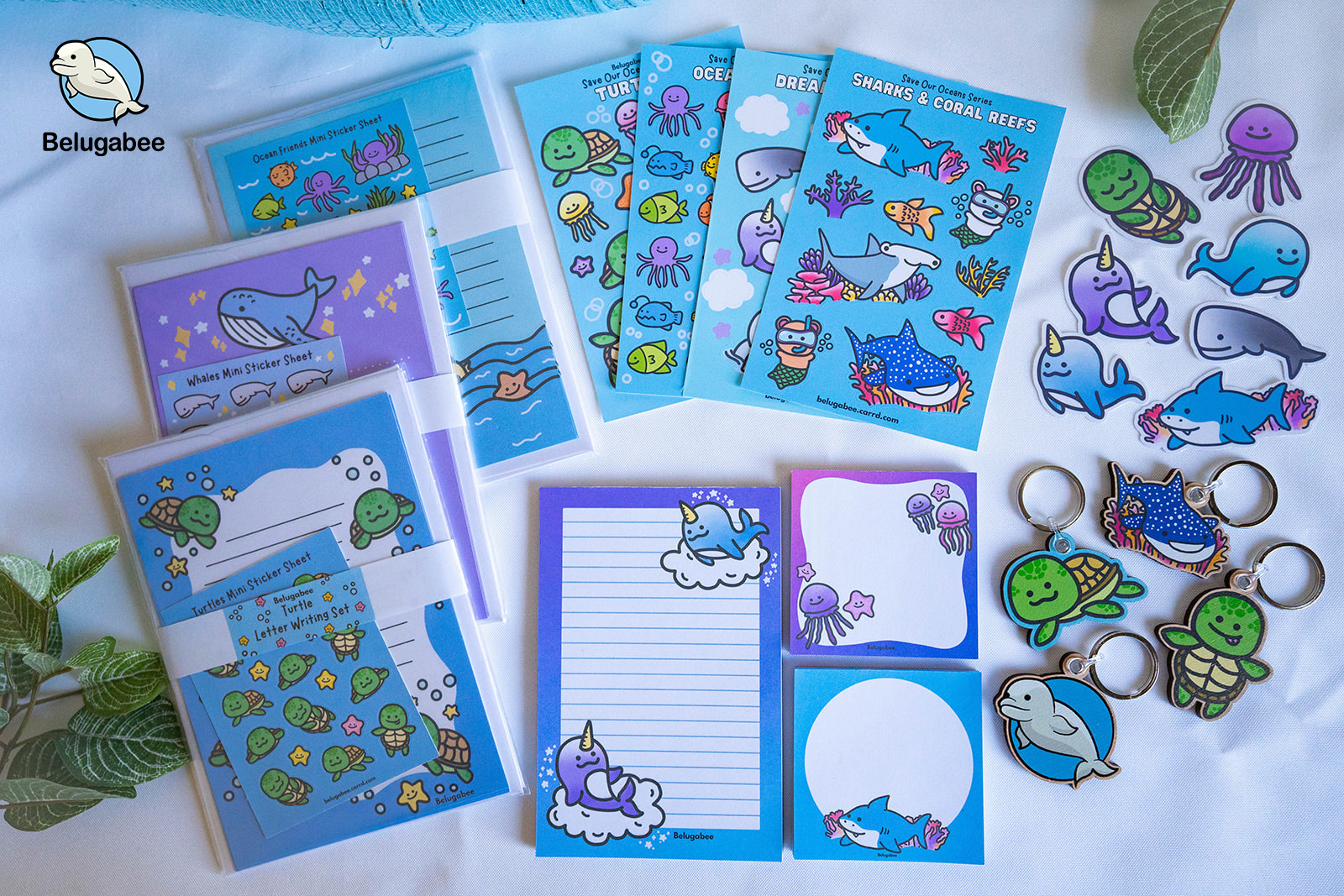 This is an image of some of Belugabee products. Some blue and purple stickers, notepads and sticky notes.