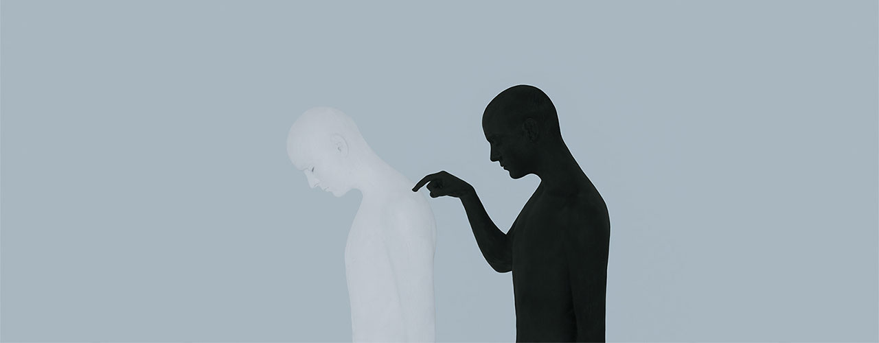 This image is of a white, human silhouette being poked in the back by it's shadow. The image is named 'the self and the shadow'.