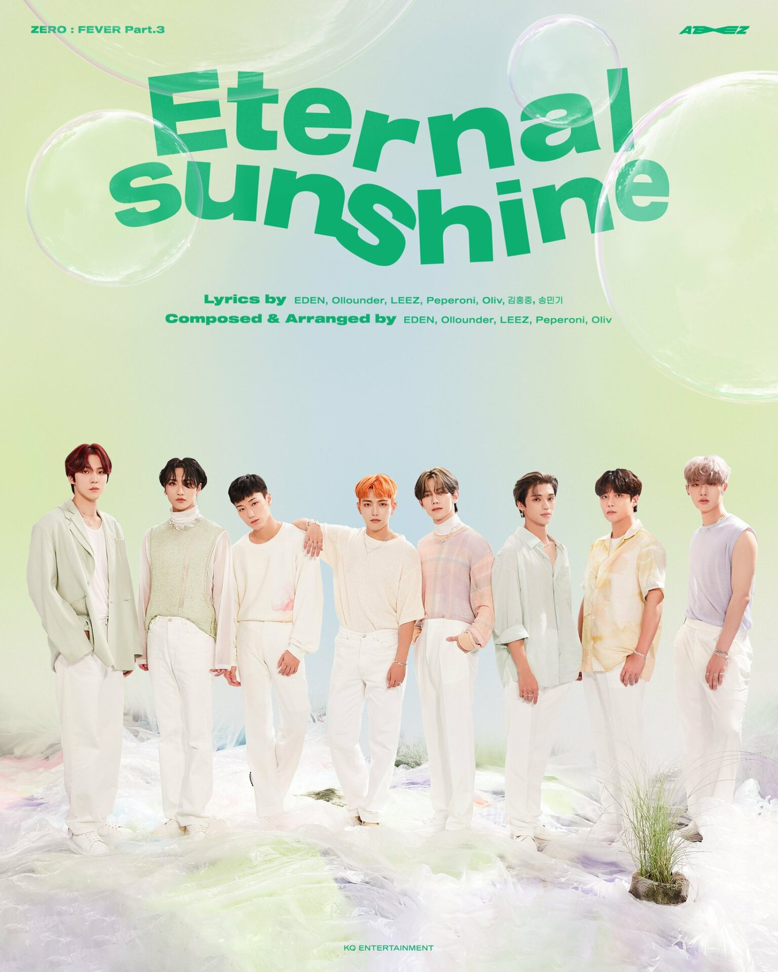 """This image is the cover of ATEEZ's single """"Eternal Sunshine"""". The 8 boys are all dressed in whites and pastel greens to match the background and the green title."""
