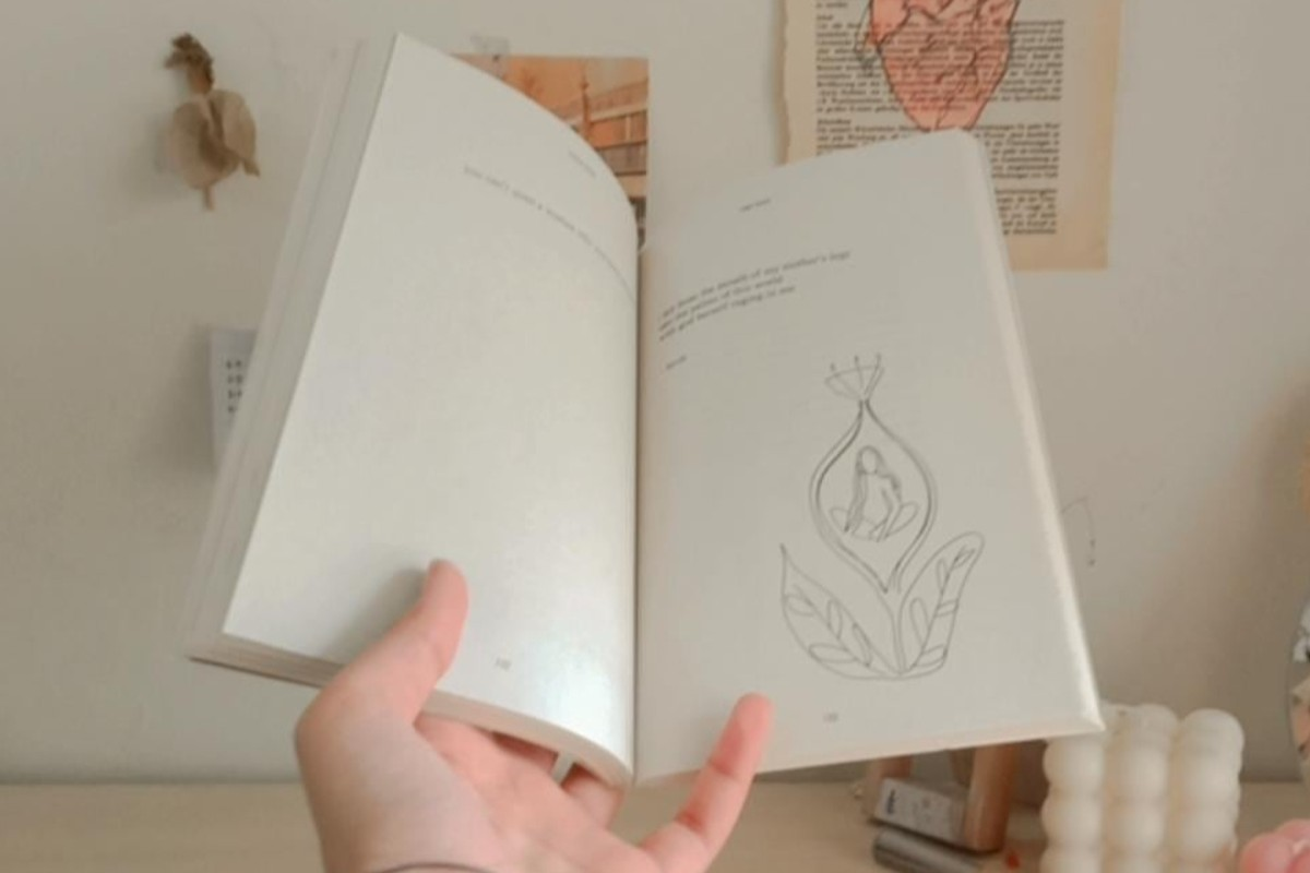 In this image, SHR med student is holding a book open and has taken a photo of inside the book.