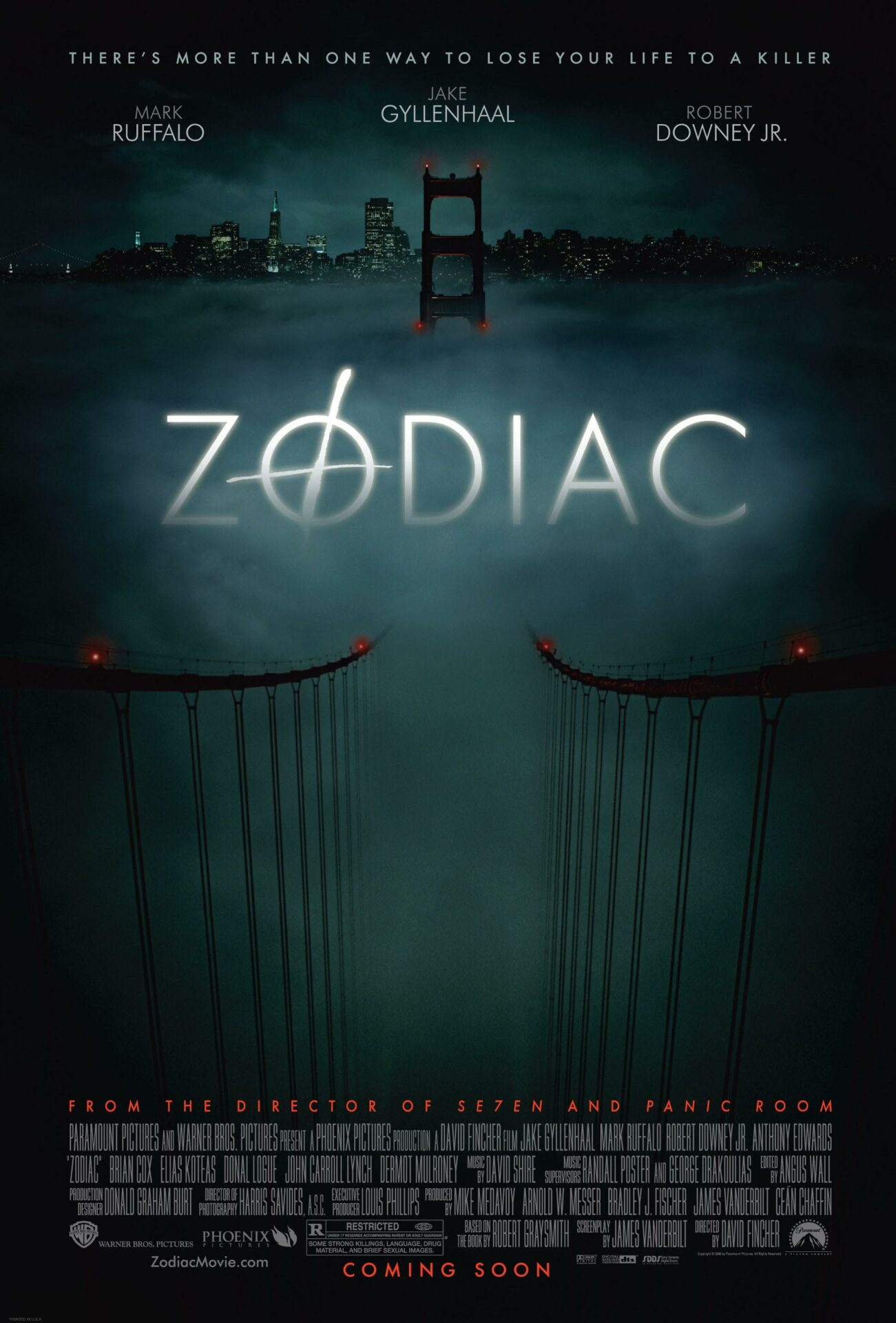 This is an image of the Zodiac movie poster. The background is dark, grey and murky, a bridge disappears into the mist.